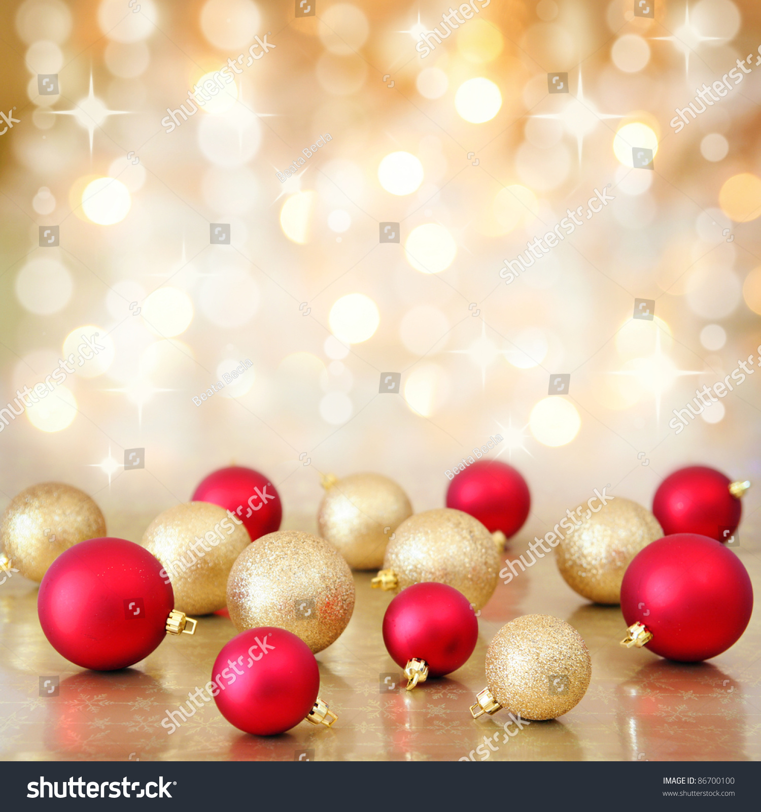 Gold and red ornaments - Red And Gold Christmas Baubles Ornaments On Background Of Defocused Golden Lights Shallow Dof
