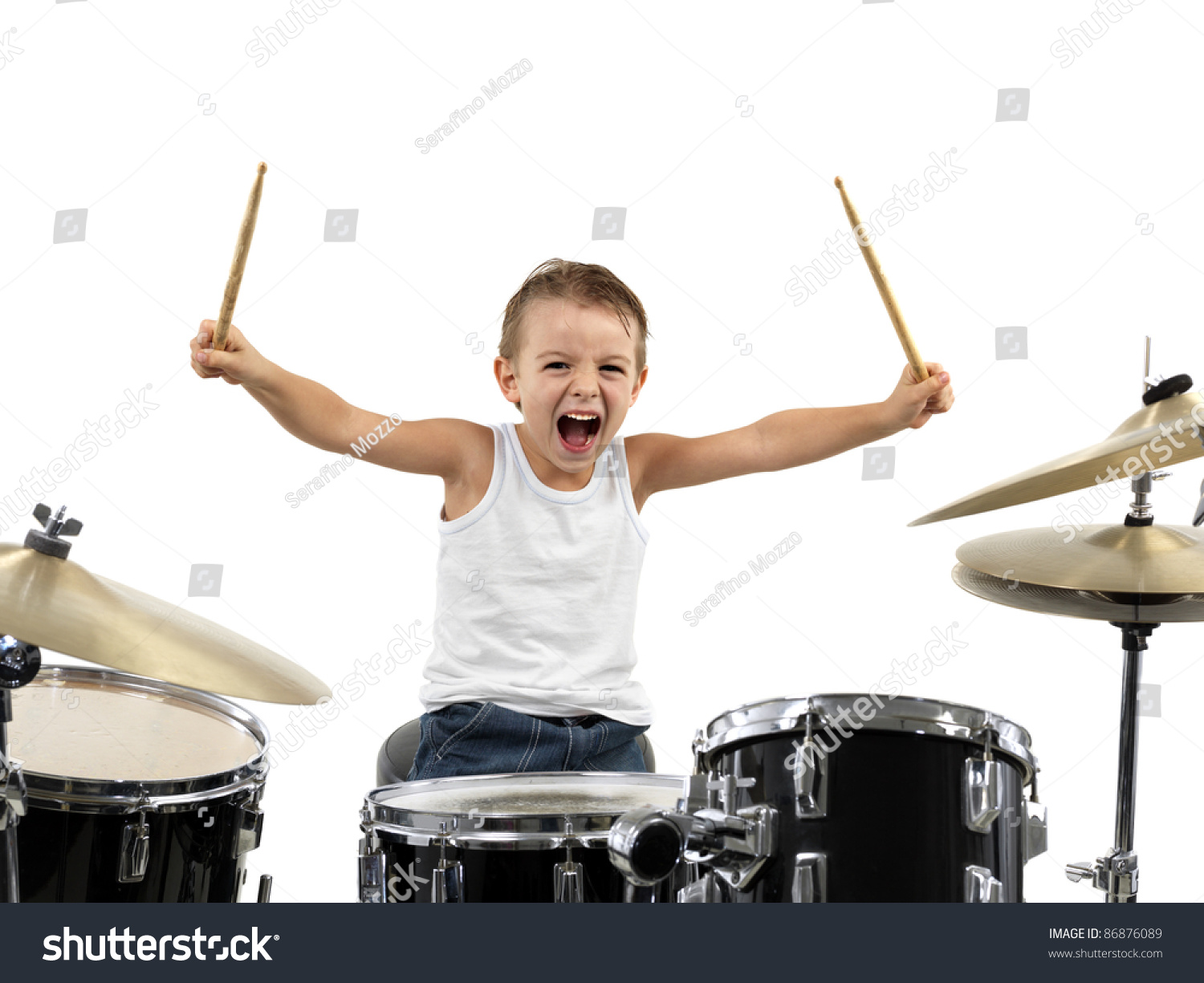 young boy play drum energy stock photo 86876089 shutterstock. Black Bedroom Furniture Sets. Home Design Ideas