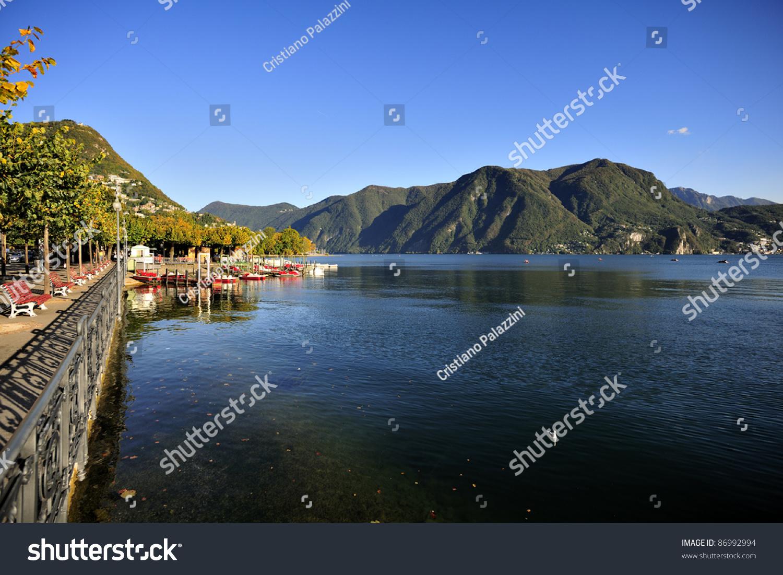 View of lugano lake and lake front walk stock photo for Lake front view