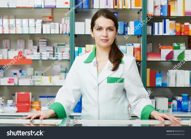 http://image.shutterstock.com/z/stock-photo-cheerful-pharmacist-chemist-woman-standing-in-pharmacy-drugstore-86999723.jpg
