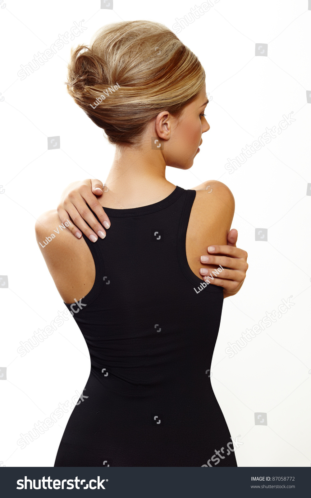 Black dress hairstyle - Beautiful Woman Wearing Hair In French Roll Updo In Sexy Black Dress Standing With Her Back