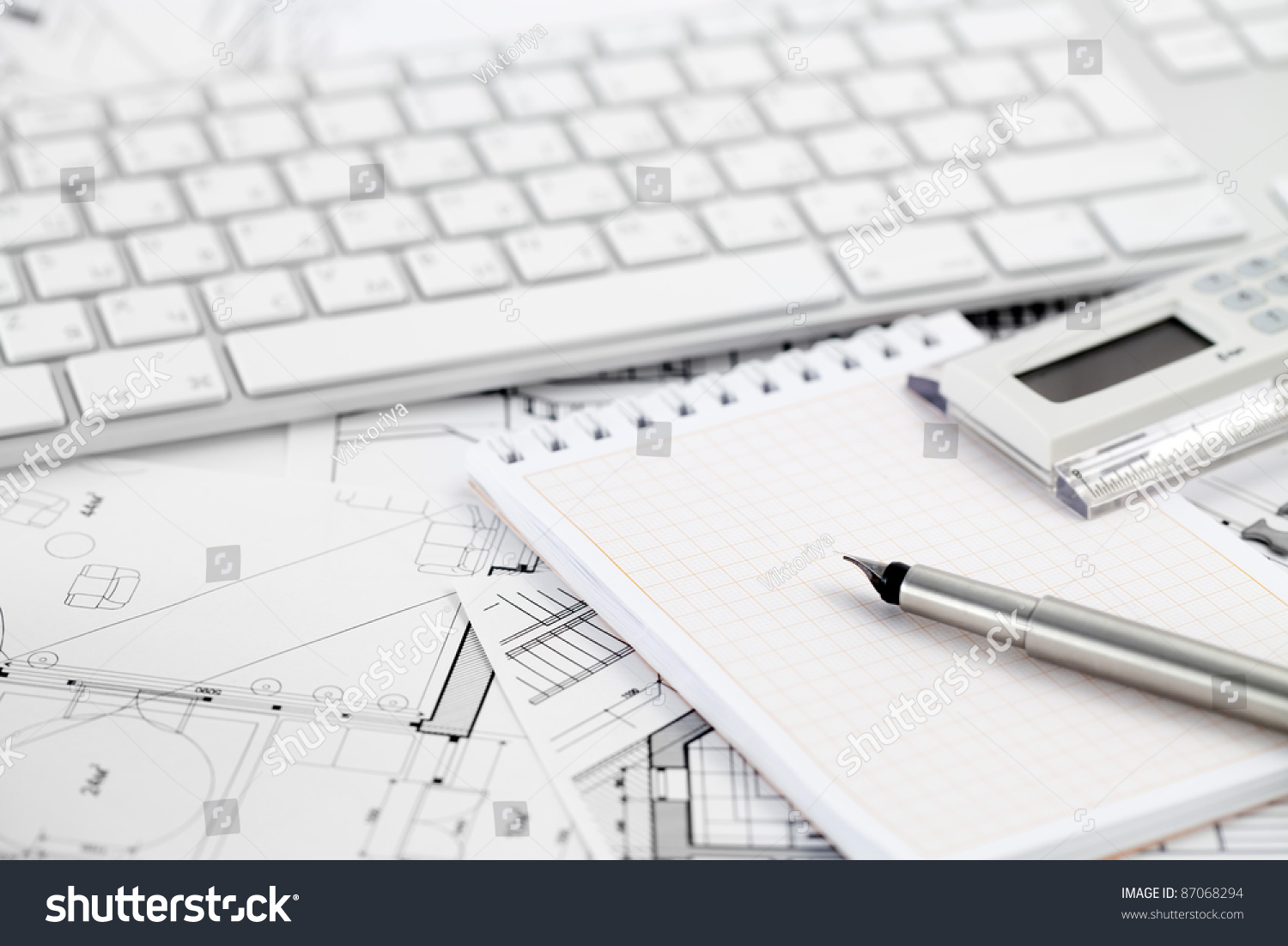 computer keyboard calculator notepad ink pen stock photo 87068294 computer keyboard calculator notepad ink pen and architectural drawings of the modern house