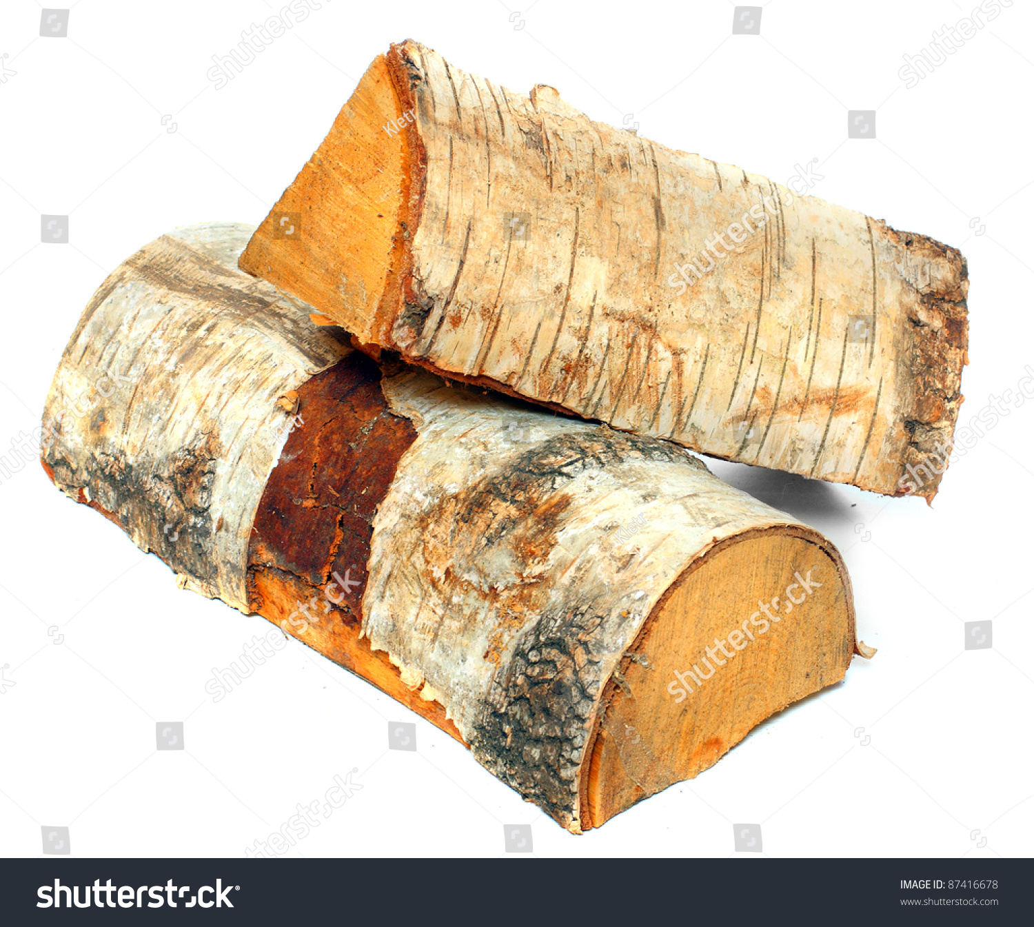 Stack of cut logs fire wood from silver birch tree betula