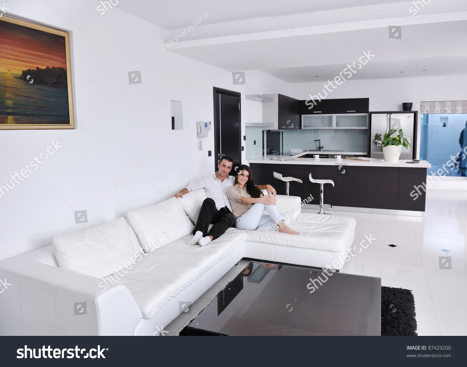 Living Room Decorating Ideas For Young Couples happy young couple relax modern home stock photo 87429200