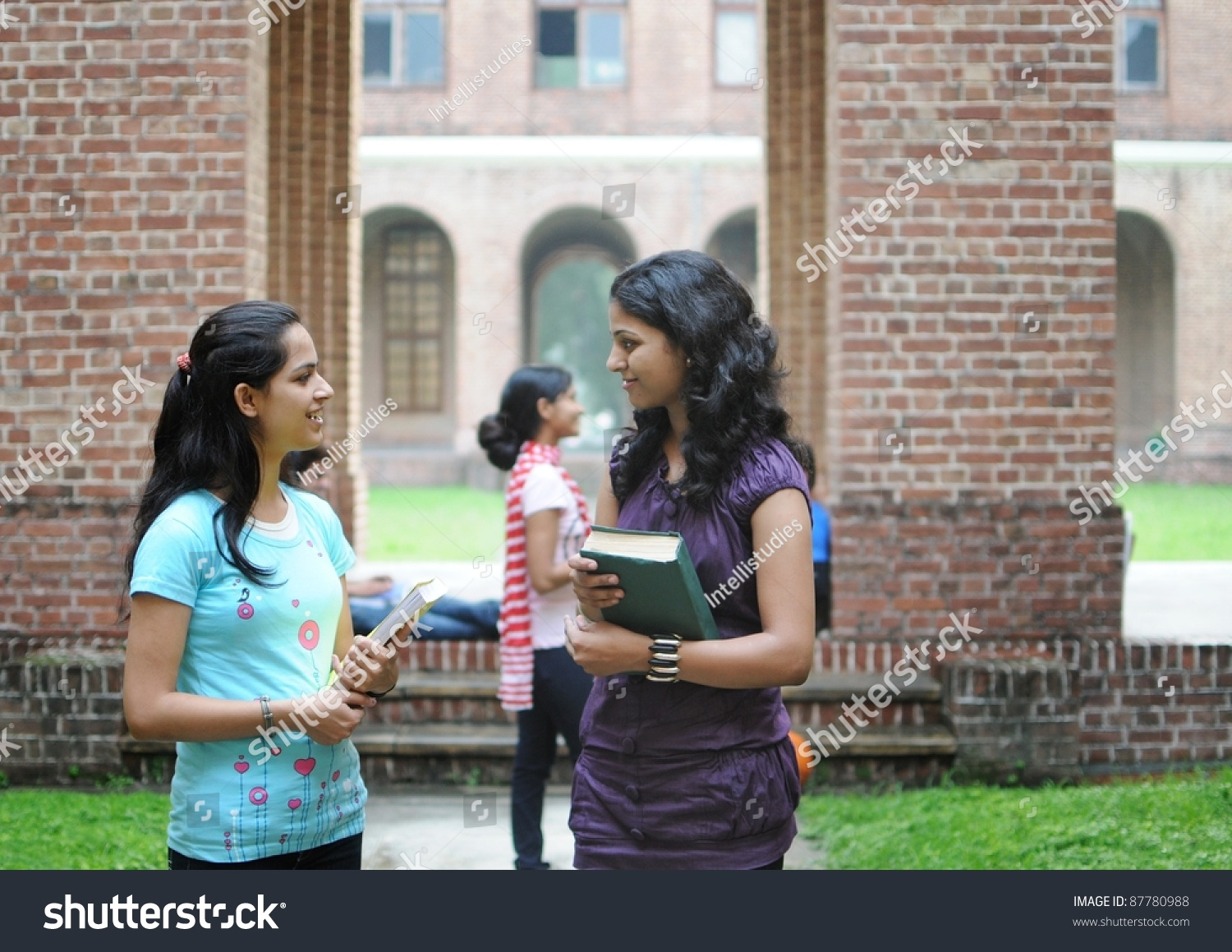 royalty-free two indian college girls talking to… #87780988 stock