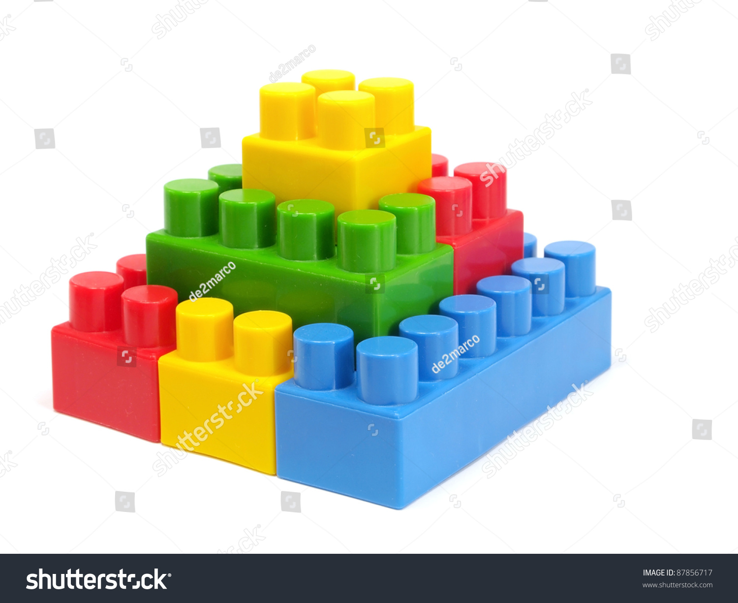 Plastic building blocks pyramid on a white background for Plastic building blocks home construction