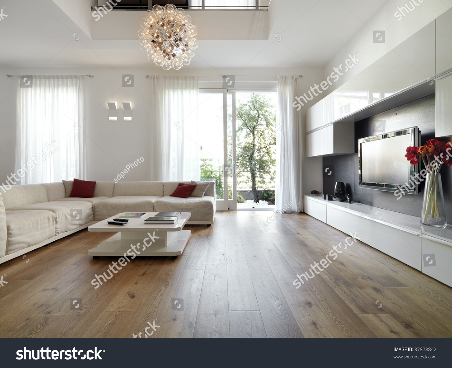Internal View Of A Modern Living Room With Wood Flooring Overlooking On The  Garden Part 78