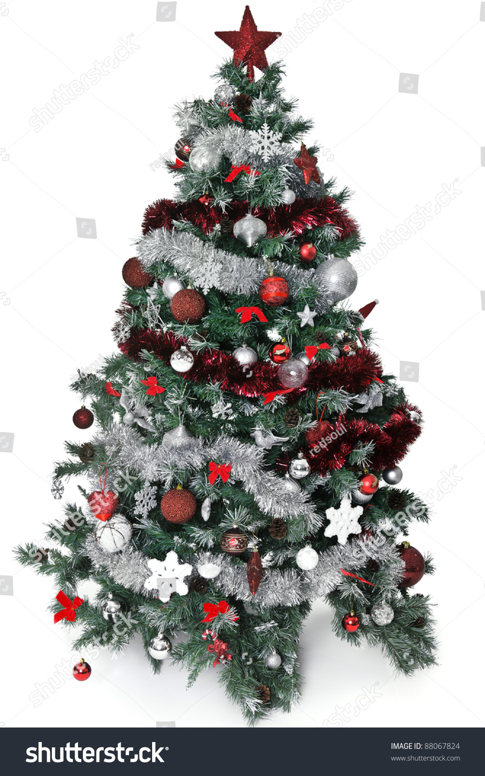 Christmas tree with lot of silver and red decoration stock for Christmas tree with red and silver decorations