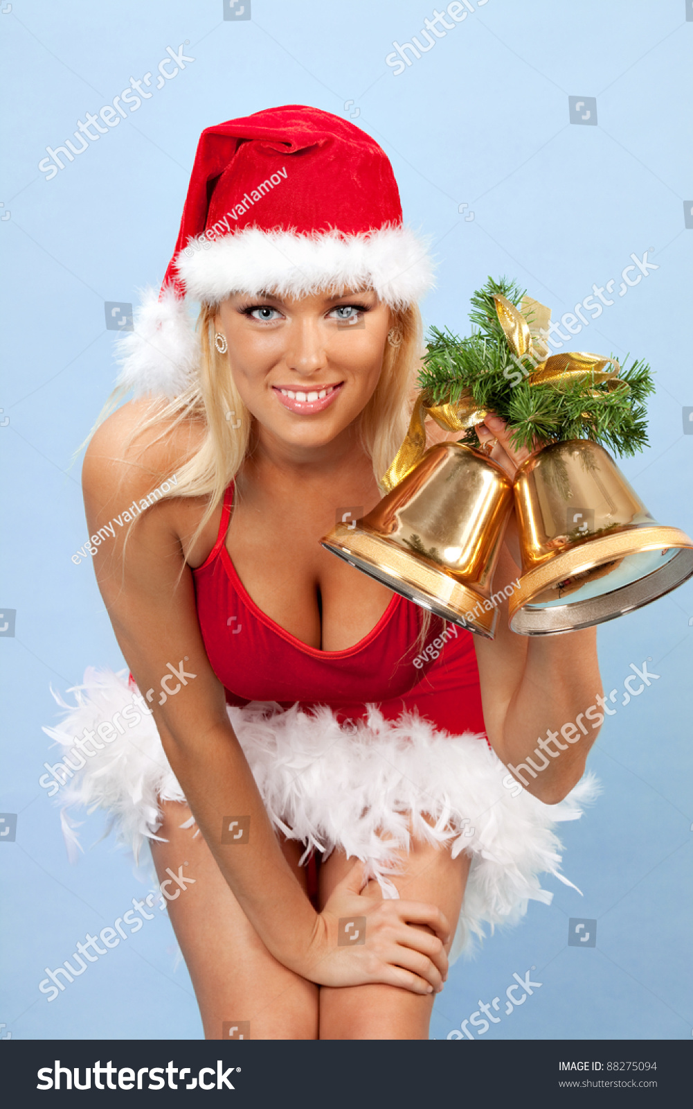 36d821c36 portrait of beautiful young woman wearing santa claus clothes with bells
