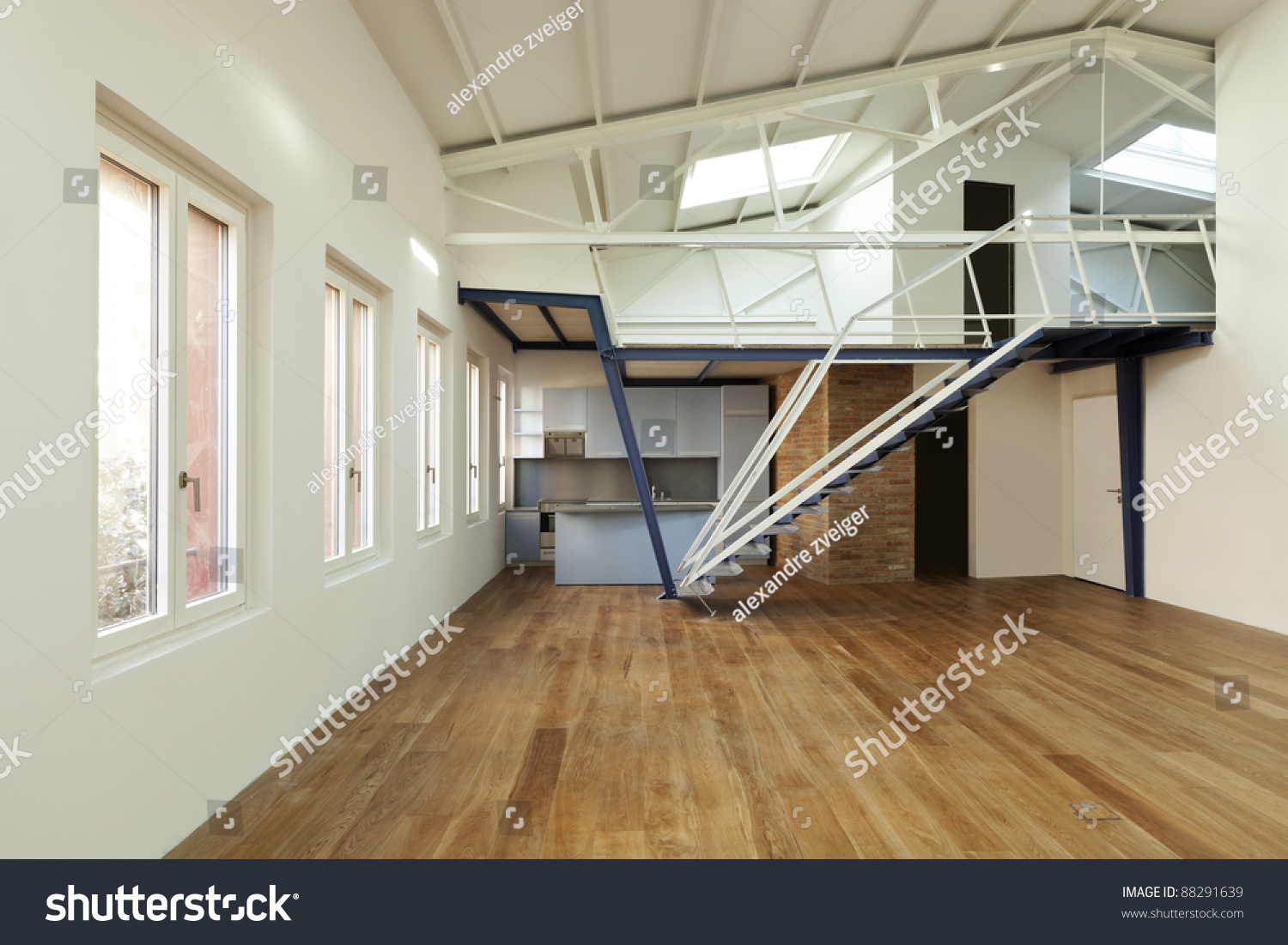 Modern Designer Apartment With Mezzanine Stock Photo