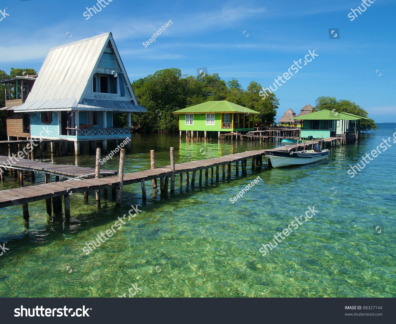 caribbean resort over sea wooden dock stock photo 88327144. Black Bedroom Furniture Sets. Home Design Ideas