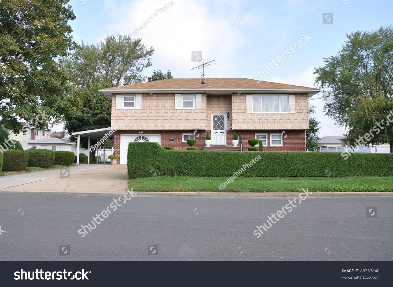 Suburban high ranch style home shrubs stock photo 88357840 for High ranch house