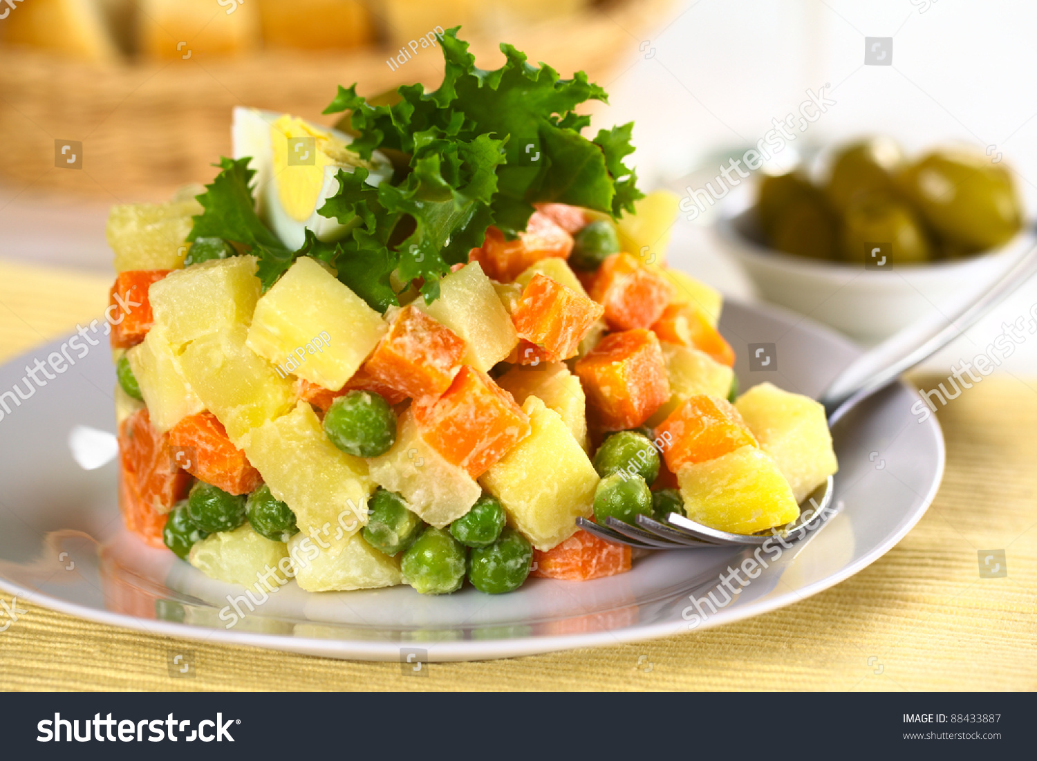 Vegetarian Russian Salad, also called Salad Olivier, made of potato ...