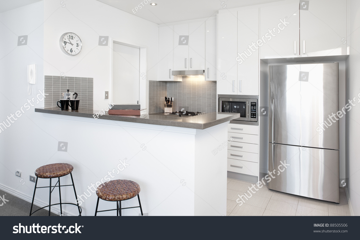 Modern white kitchen in apartment with polished stainless steel appliances stock photo 88505506 - Modern kitchen with white appliances ...