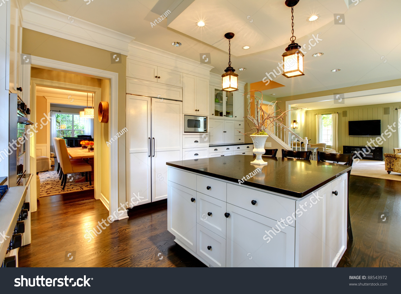Kitchen luxury with dark floor and white cabinets