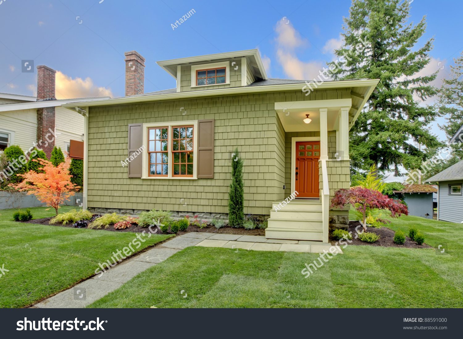Green cute small craftsman house orange stock photo for Small craftsman house