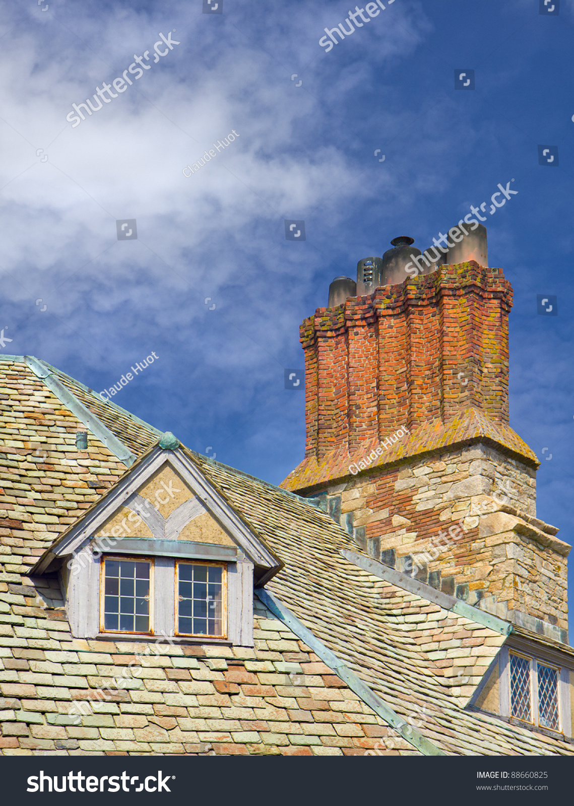 Traditional English chimney stack and windows on old house