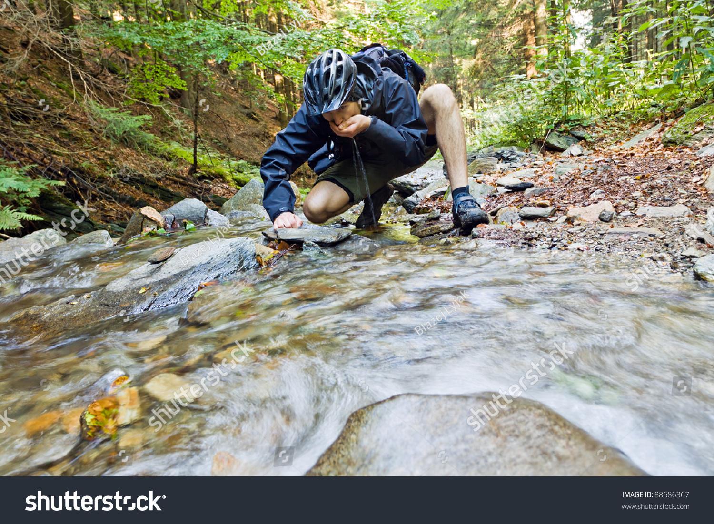 Mountain biker drinking water spring stock photo 88686367 mountain biker drinking water from a spring biocorpaavc