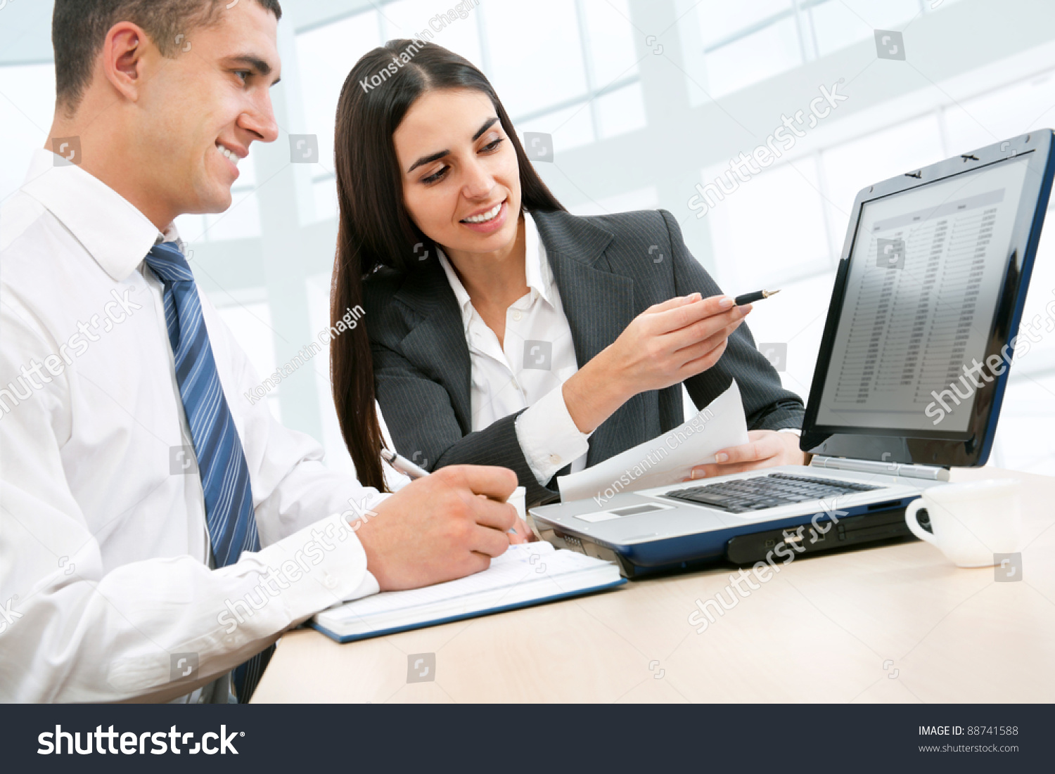 Young Business People Working Over A Laptop Computer Stock ...