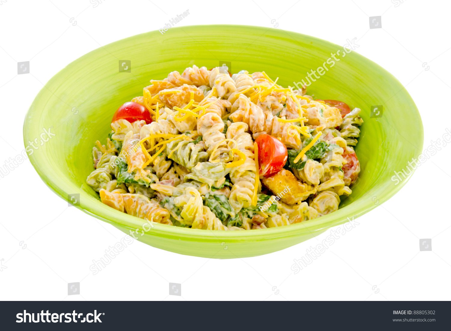 Cheesy bacon, lettuce and tomato pasta salad in green bowl isolated on ...