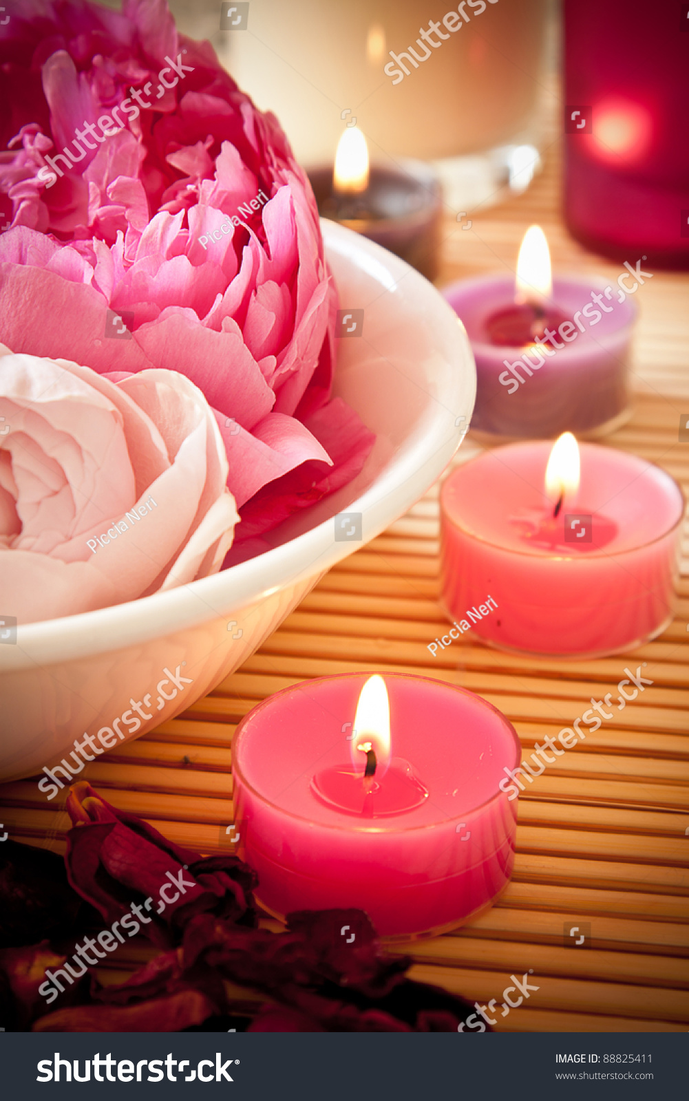 Candle flowers images candles flowers and pebbles