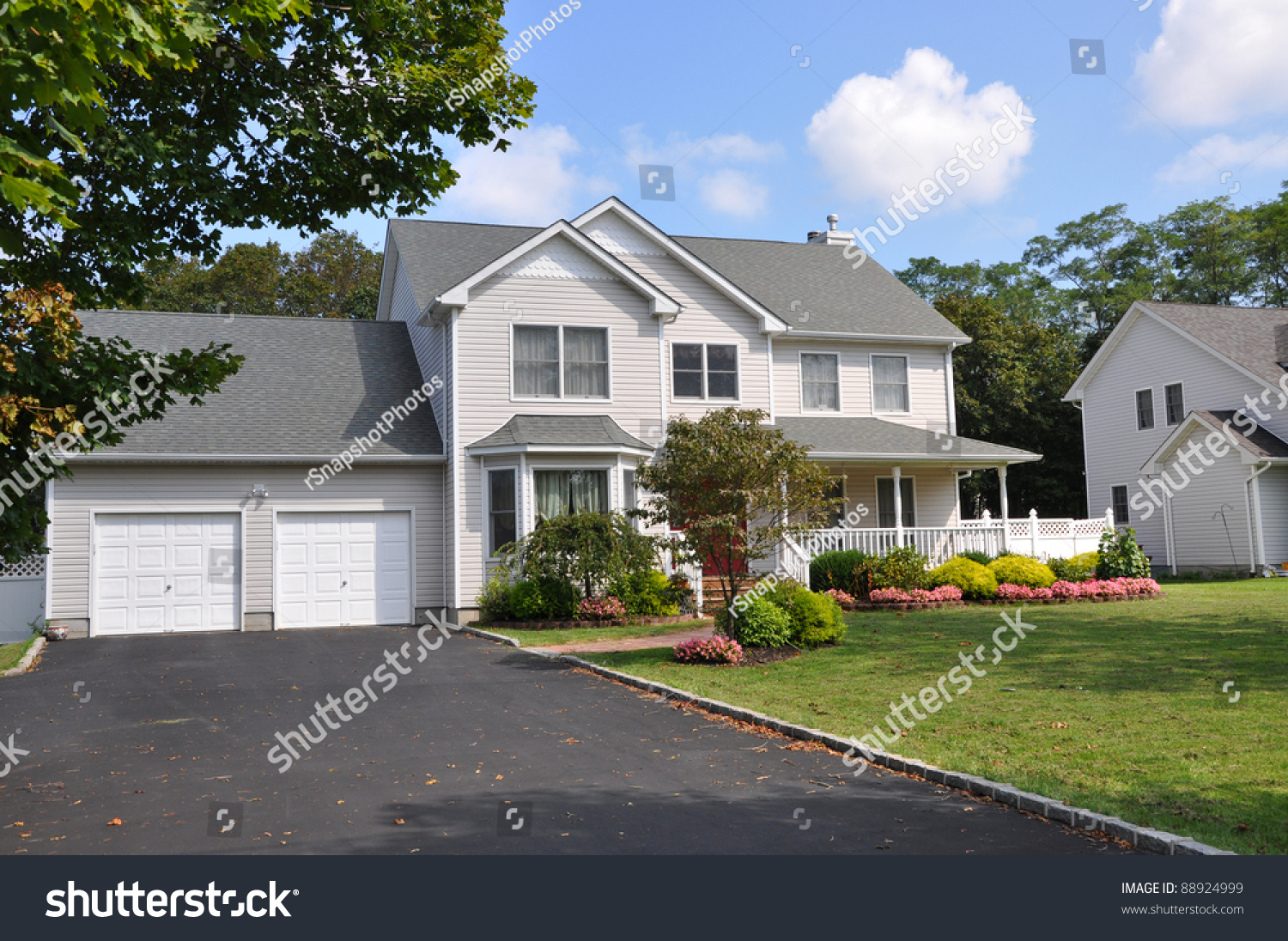 Suburban two car garage large siding home with double wide for How wide is a two car garage