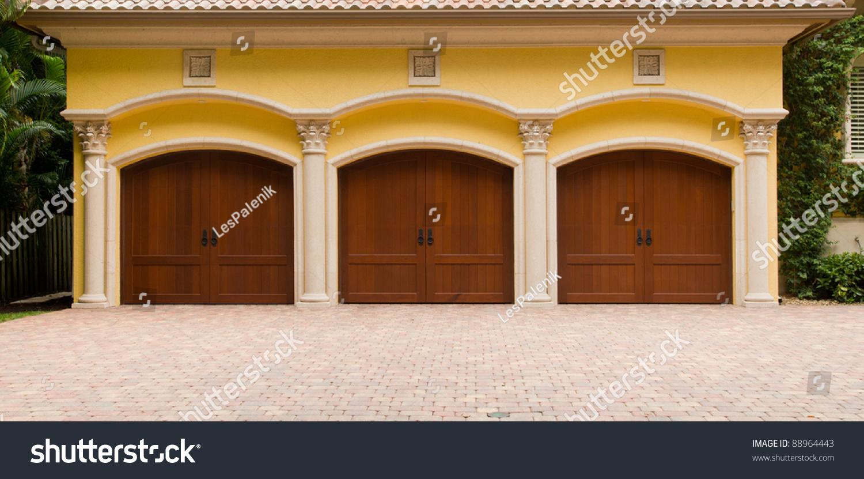 Triple garage wooden doors stock photo 88964443 shutterstock triple garage with wooden doors rubansaba