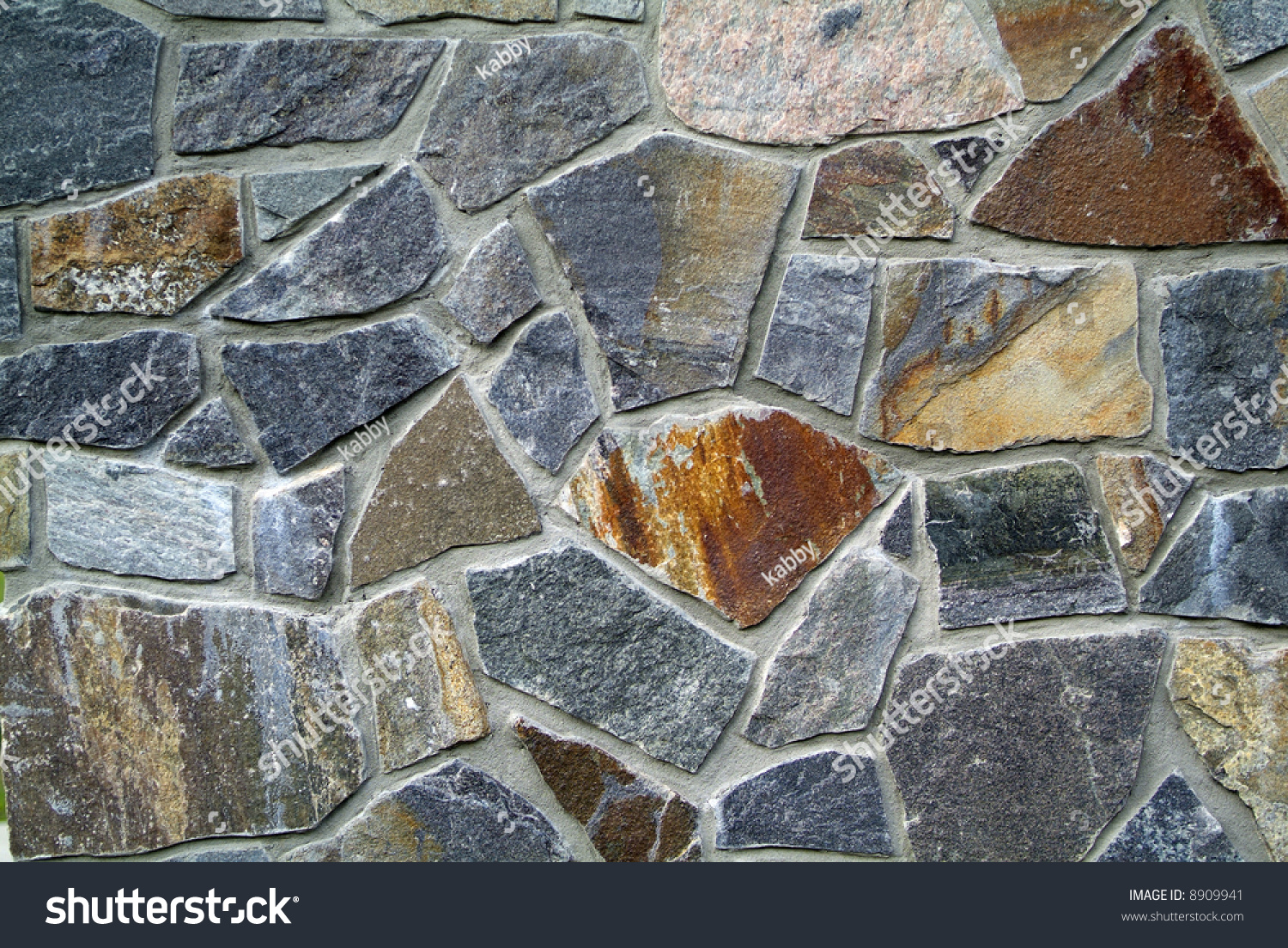 Greyand Rust Colored Stone Wall Stock Photo (Edit Now