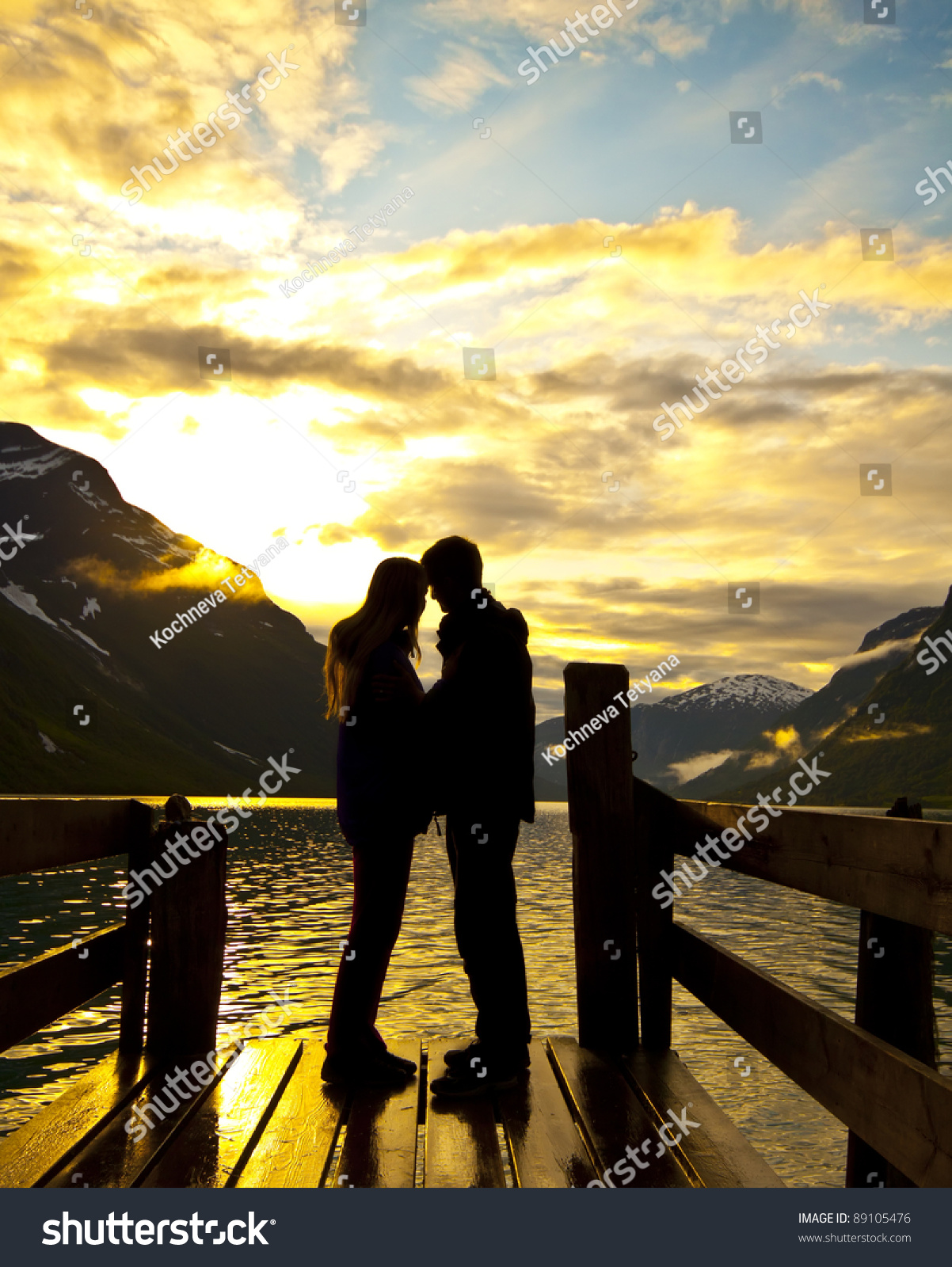 Silhouette of two lovers at mountain lake stock photo for 2 lovers pic