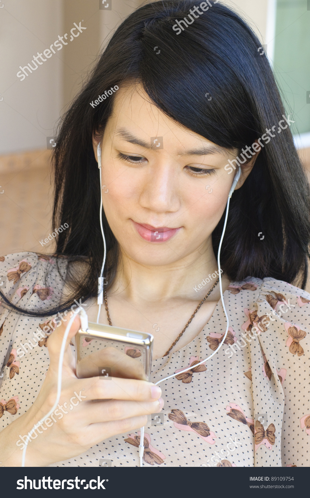 cute asian girl listening music earbuds stock photo (royalty free