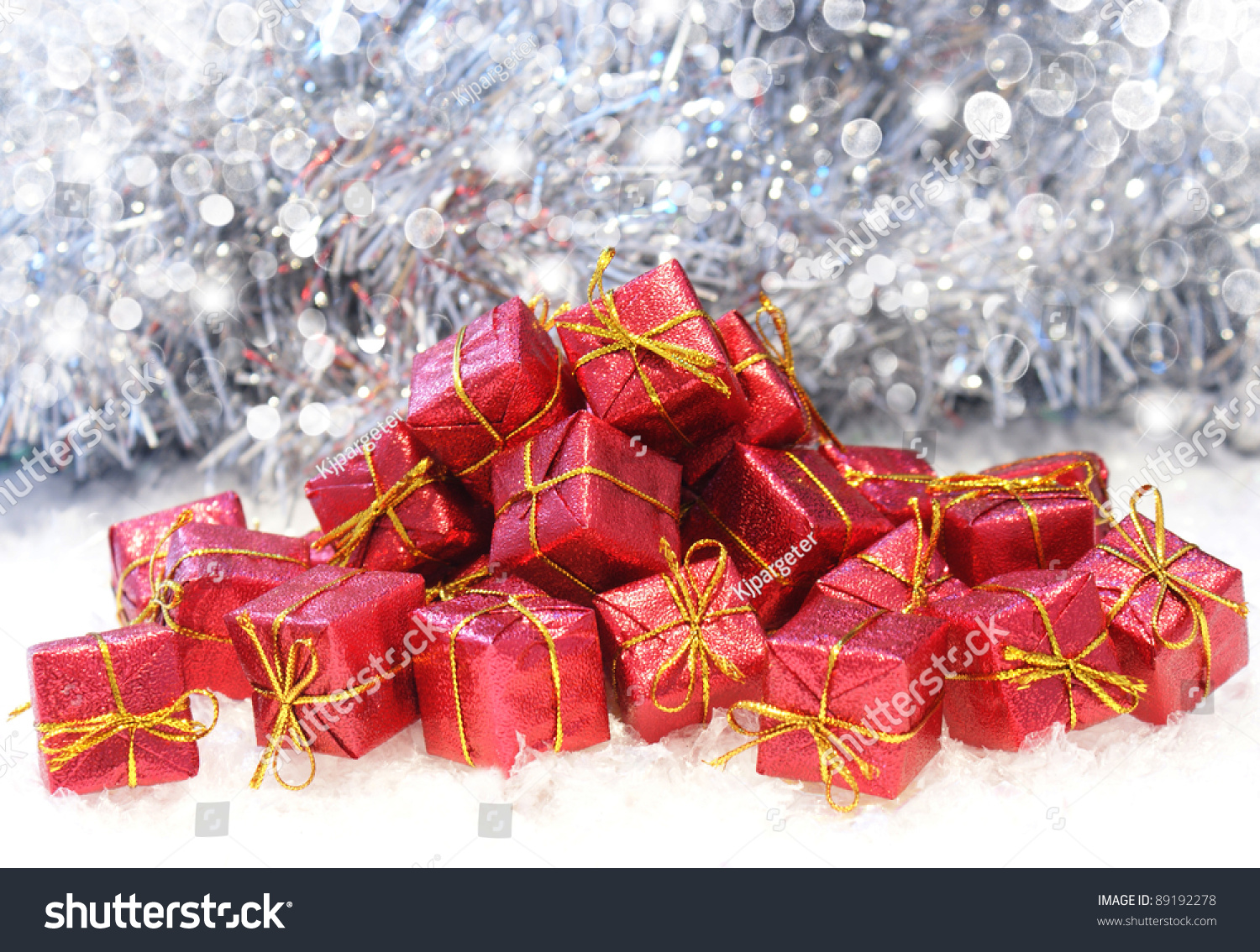 Christmas gifts in snow on a bokeh lights background | EZ Canvas
