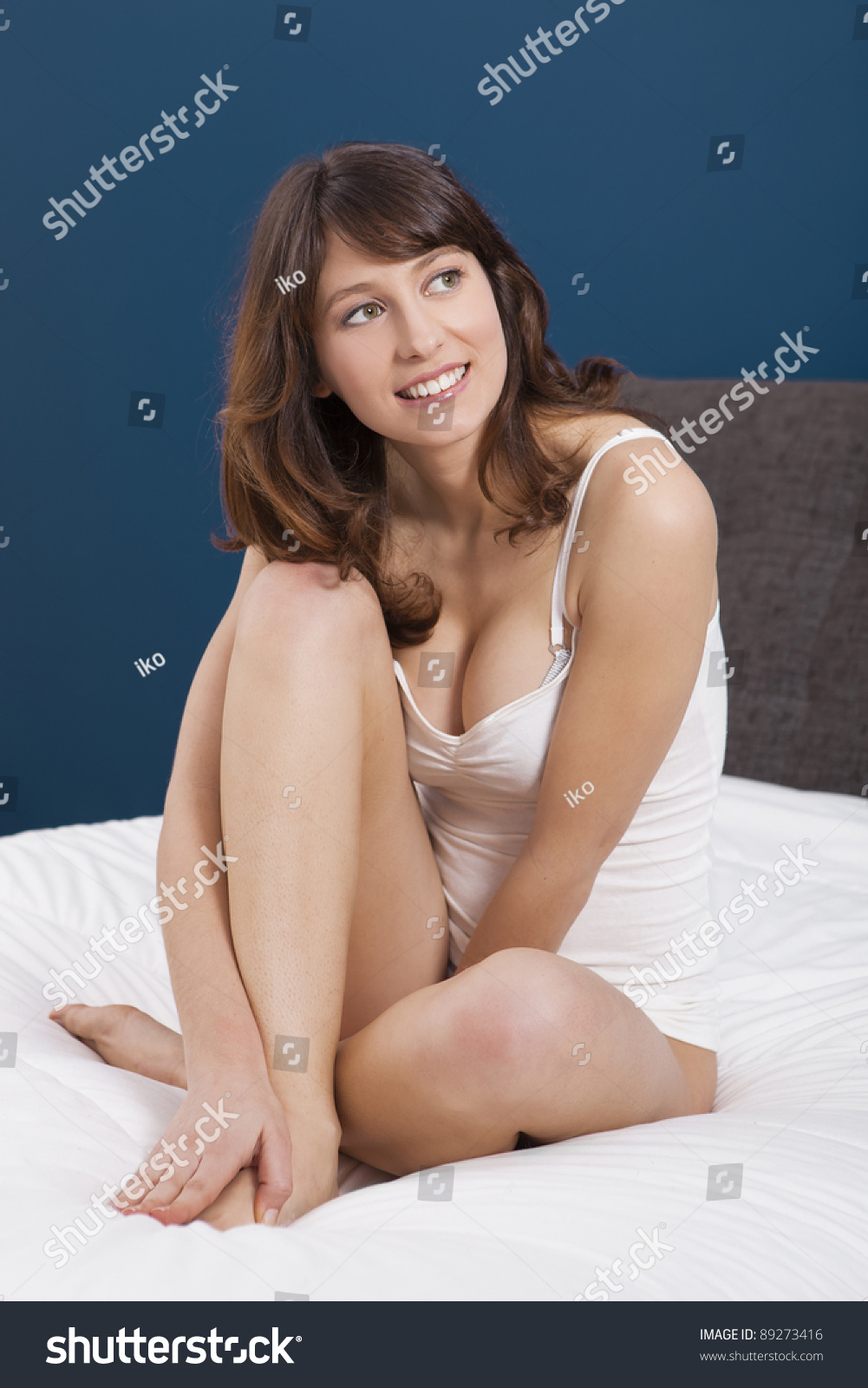beautiful girls underwear sitting on bed stock photo (edit now