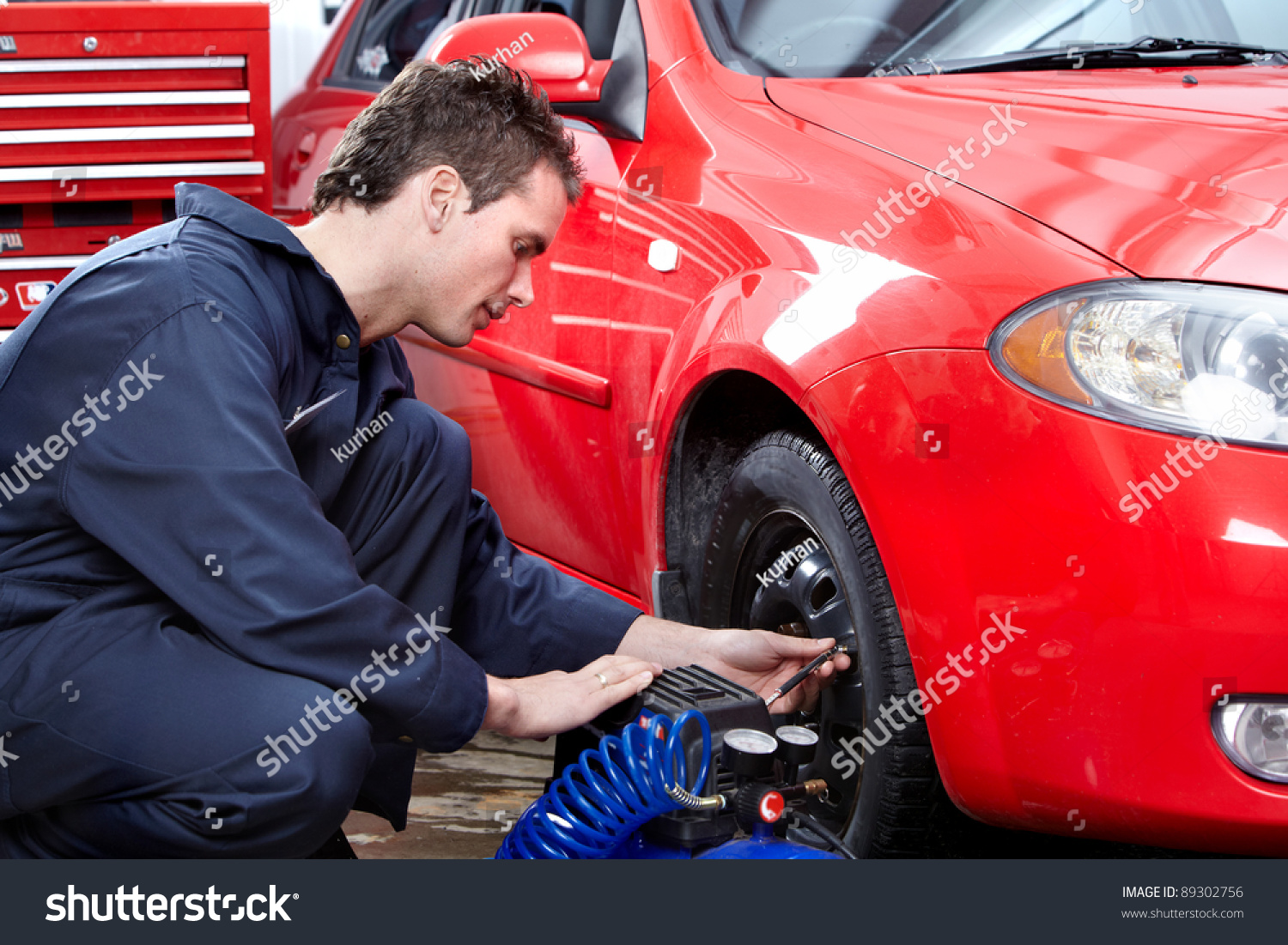 Professional Auto Mechanic Changing Tire In Auto Repair ...