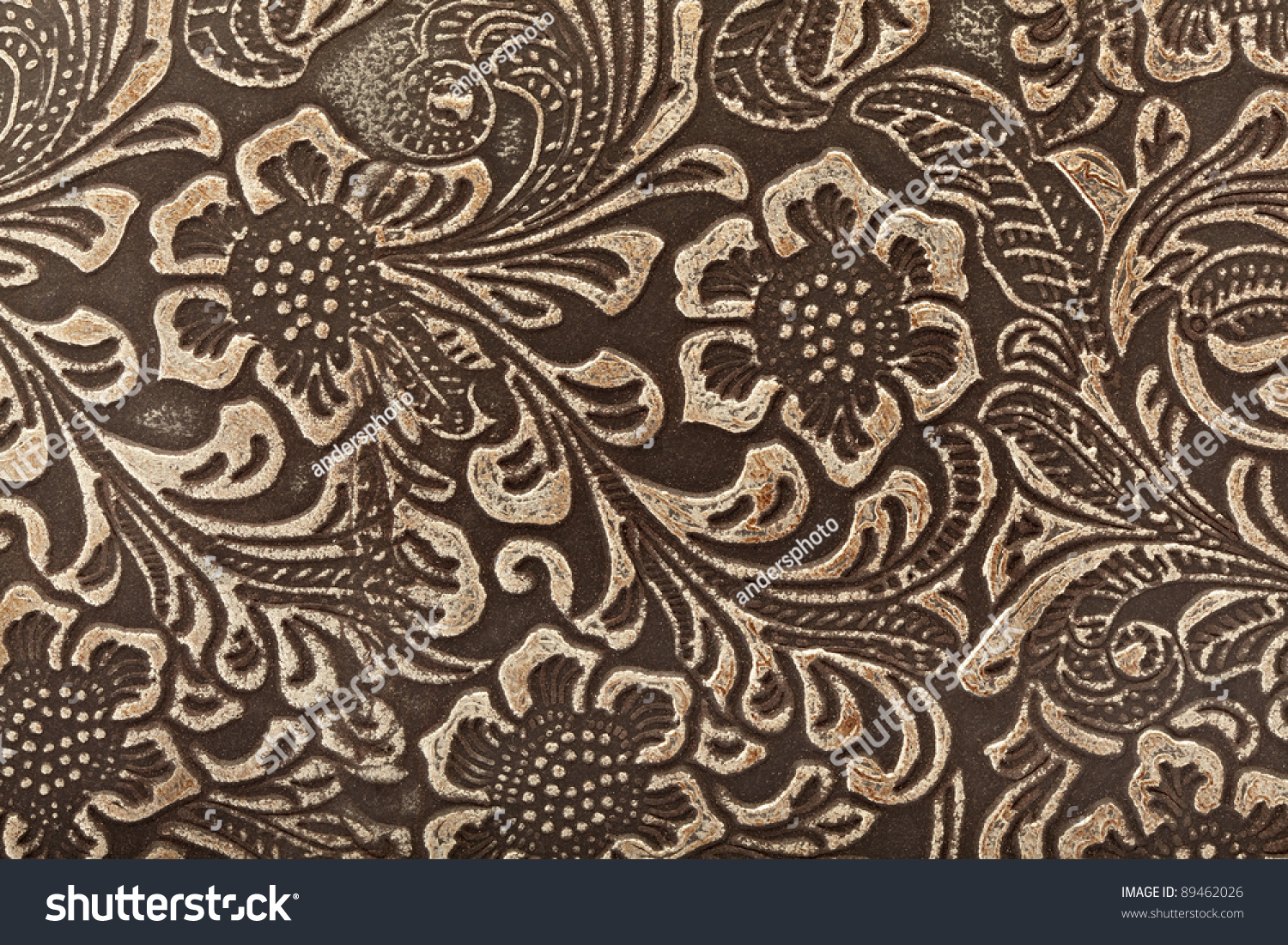 tooled leather floral pattern background stock photo