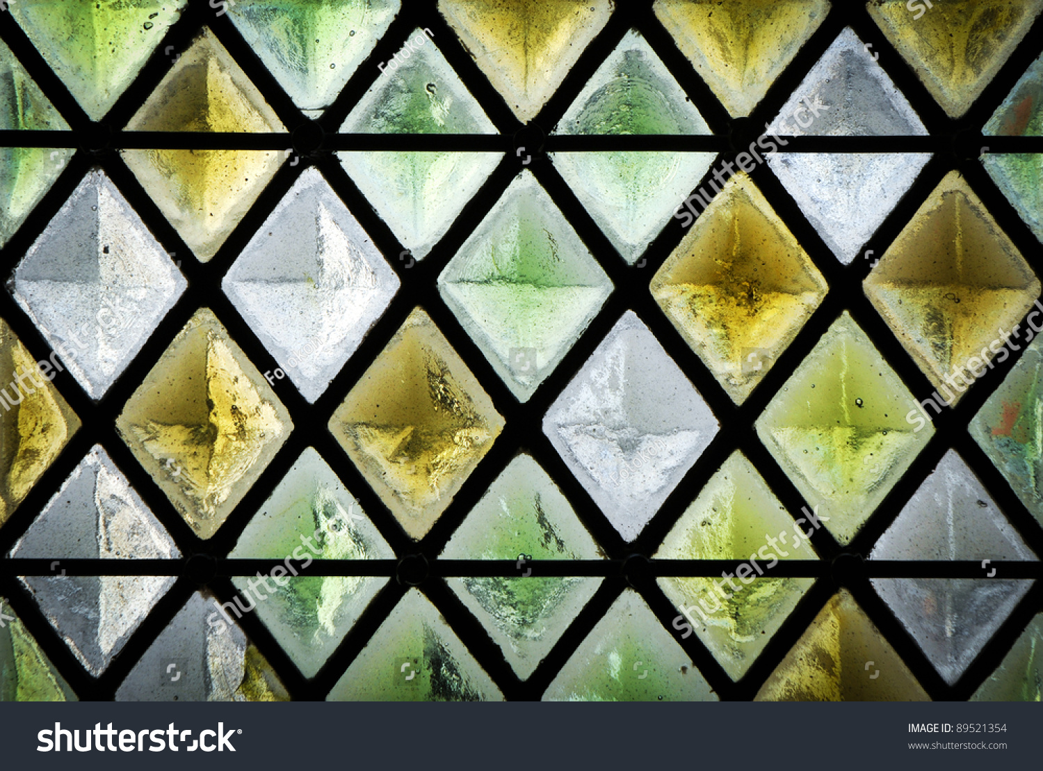 Diamond Shaped Pattern Of A Stained Glass Window Stock