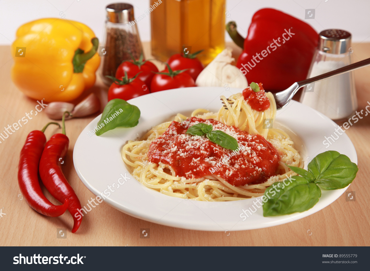 ... spaghetti are served with tomato sauce, basil and Parmesan cheese