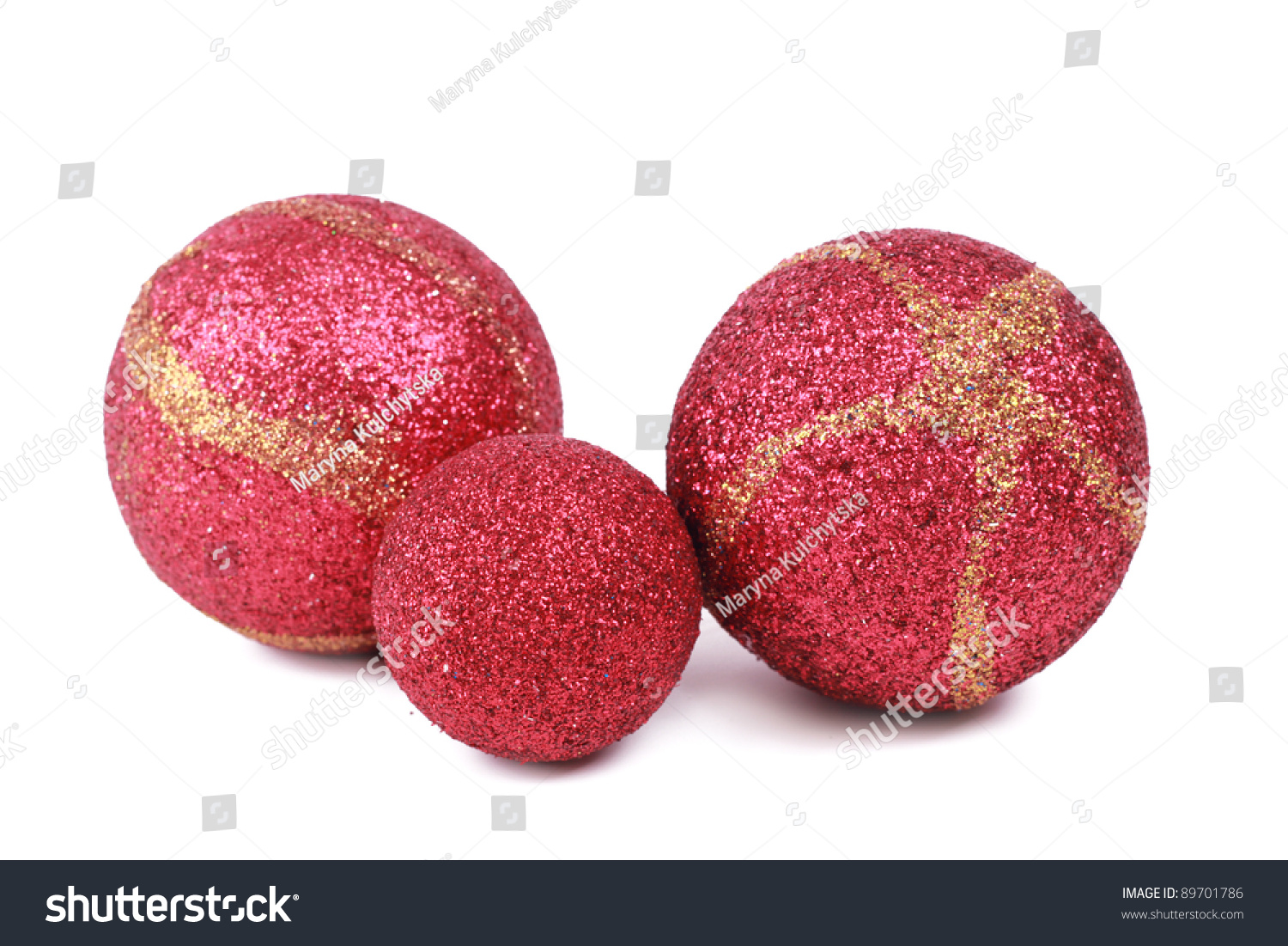 Three red sparkle balls over white background christmas