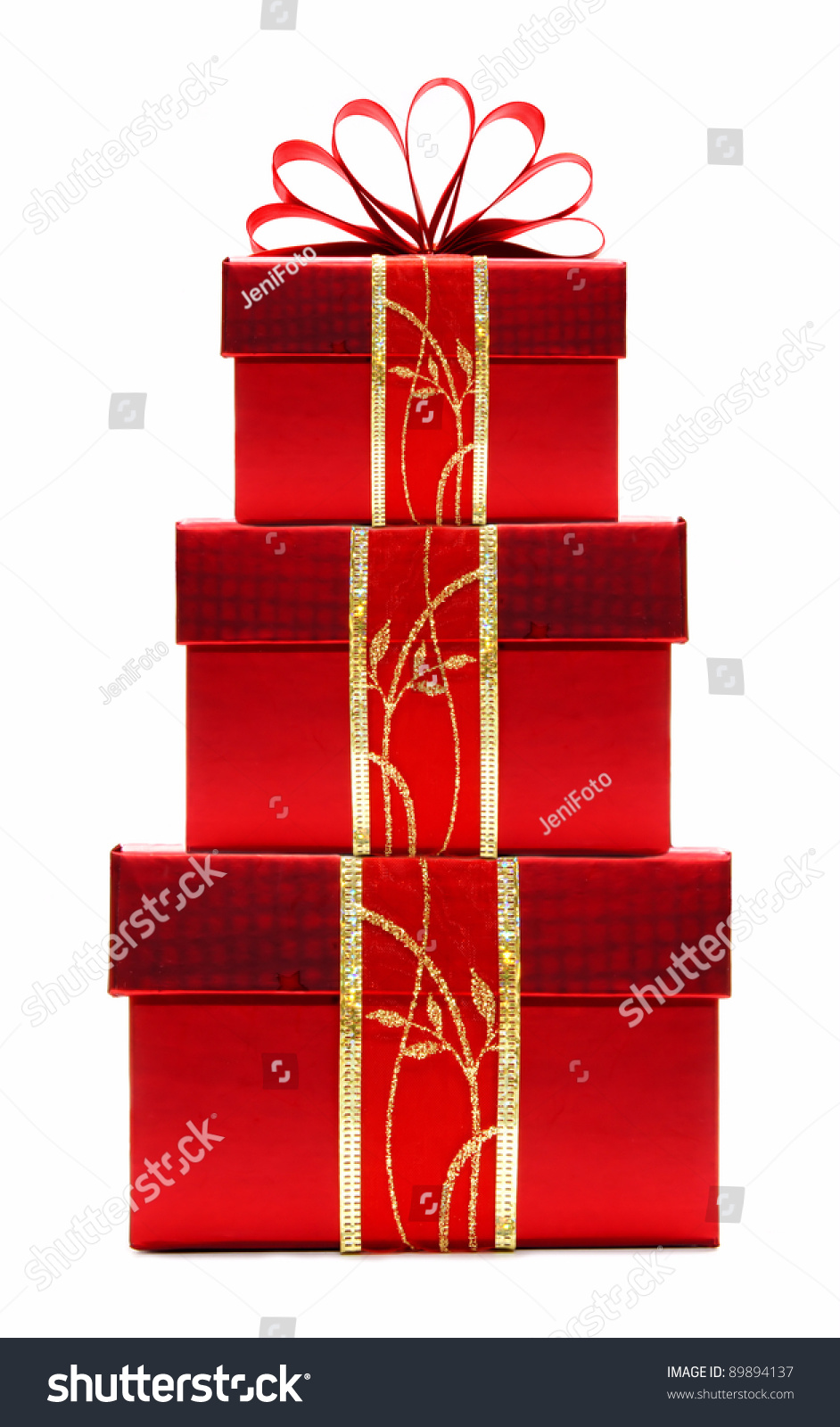Stacked red christmas gift boxes with ribbon and bow