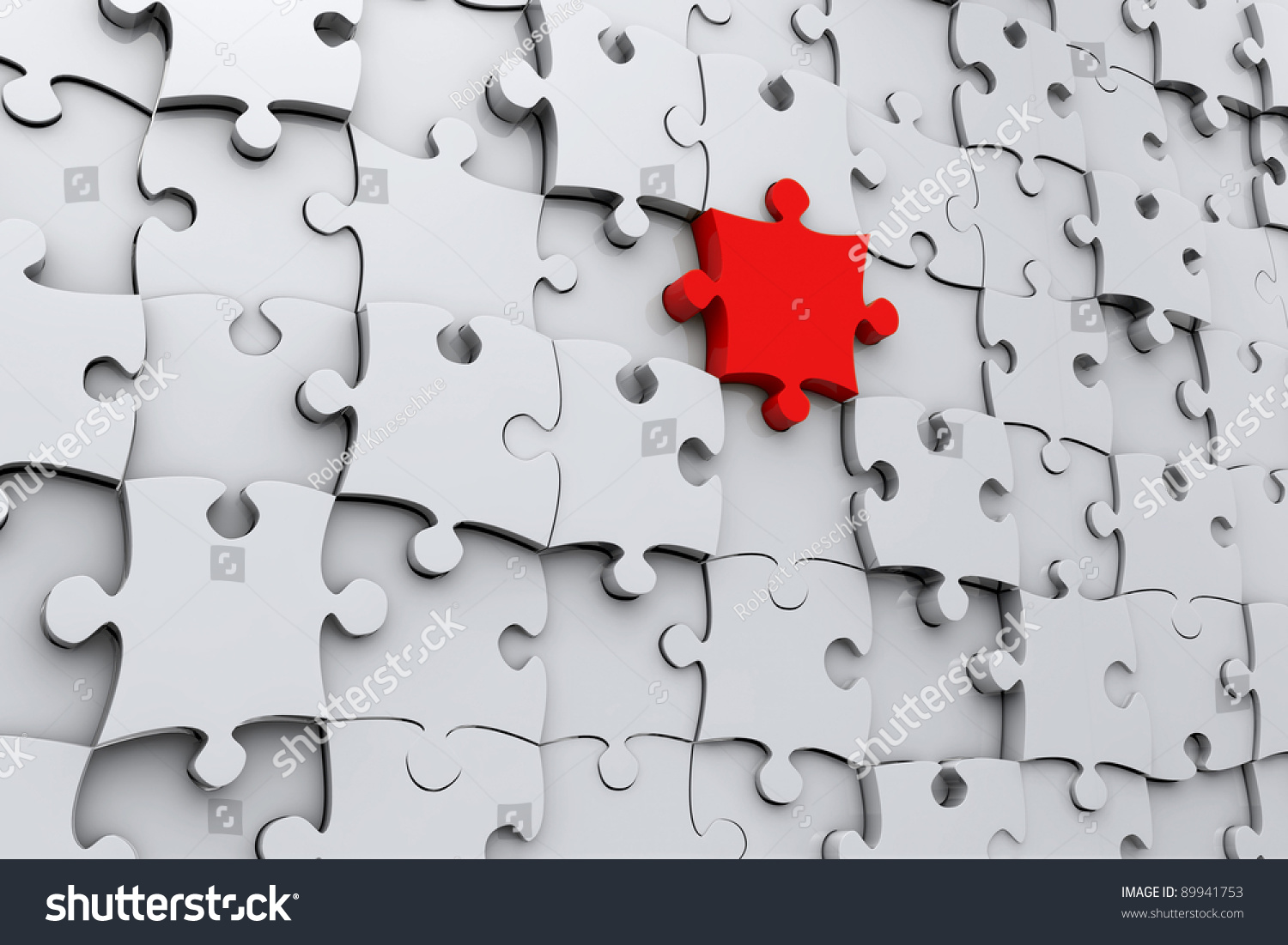 Red Jigsaw Puzzle Piece In 3D A Wall Of Grey Pieces