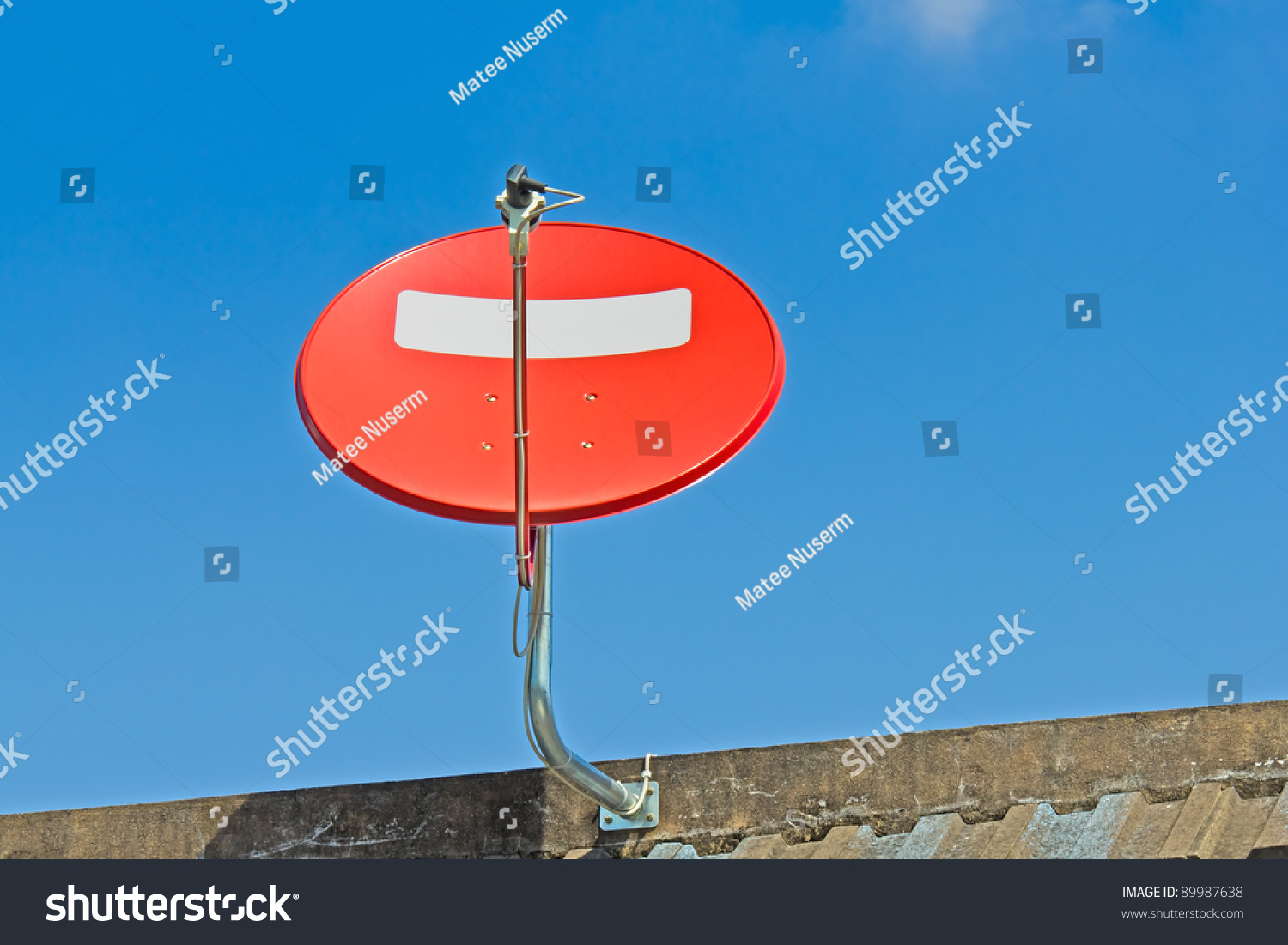 Red Satellite Dish Installing On The Roof Stock Photo