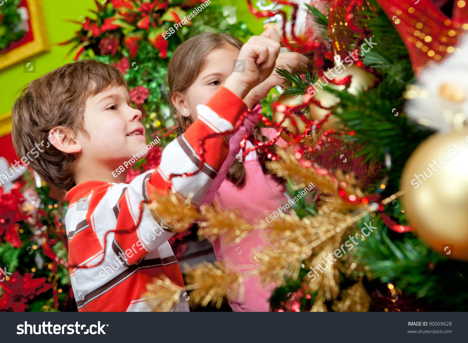 happy kids decorating a christmas tree with ornaments - Kids Decorating For Christmas