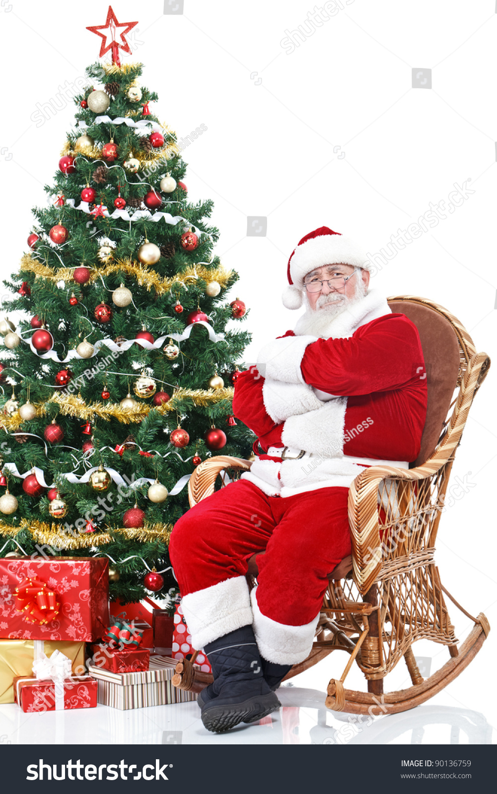Santa Claus Sitting In Rocking Chair Next Full Decorated