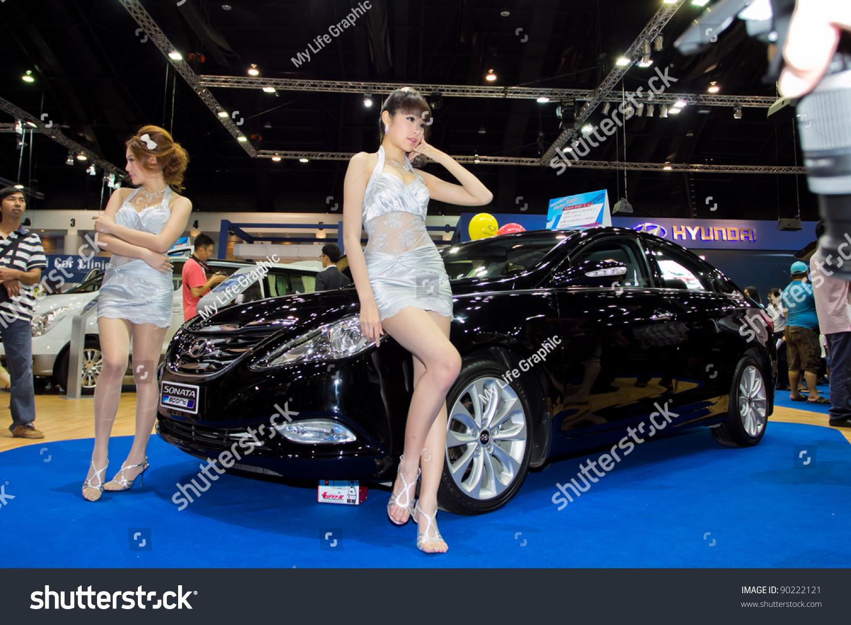 Bangkok december 4 two female presenters model at the hyundai i flow car