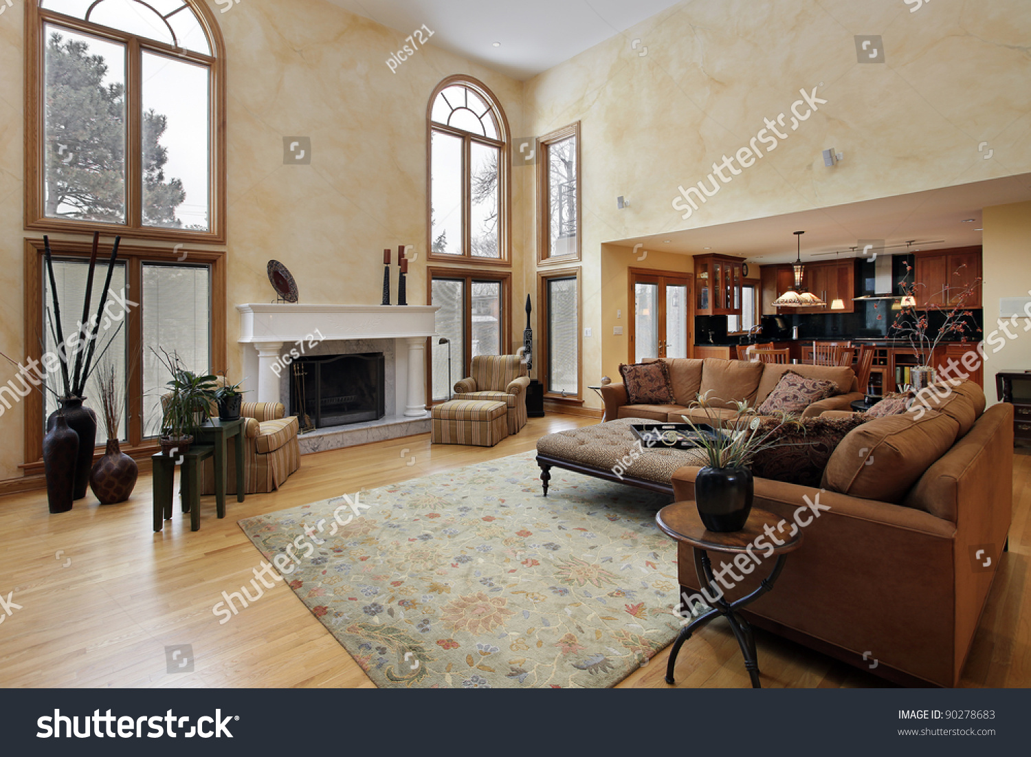 Large family room with two story curved