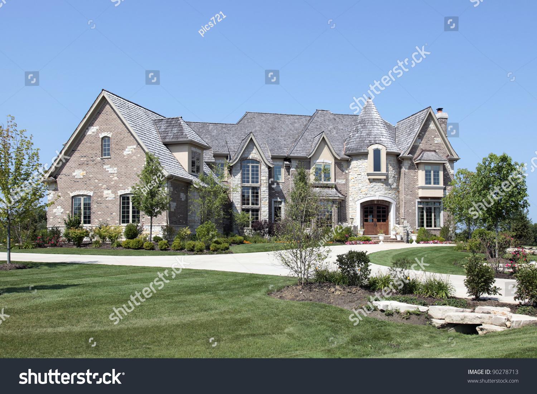 Large Luxury Brick Home With Stone Turret