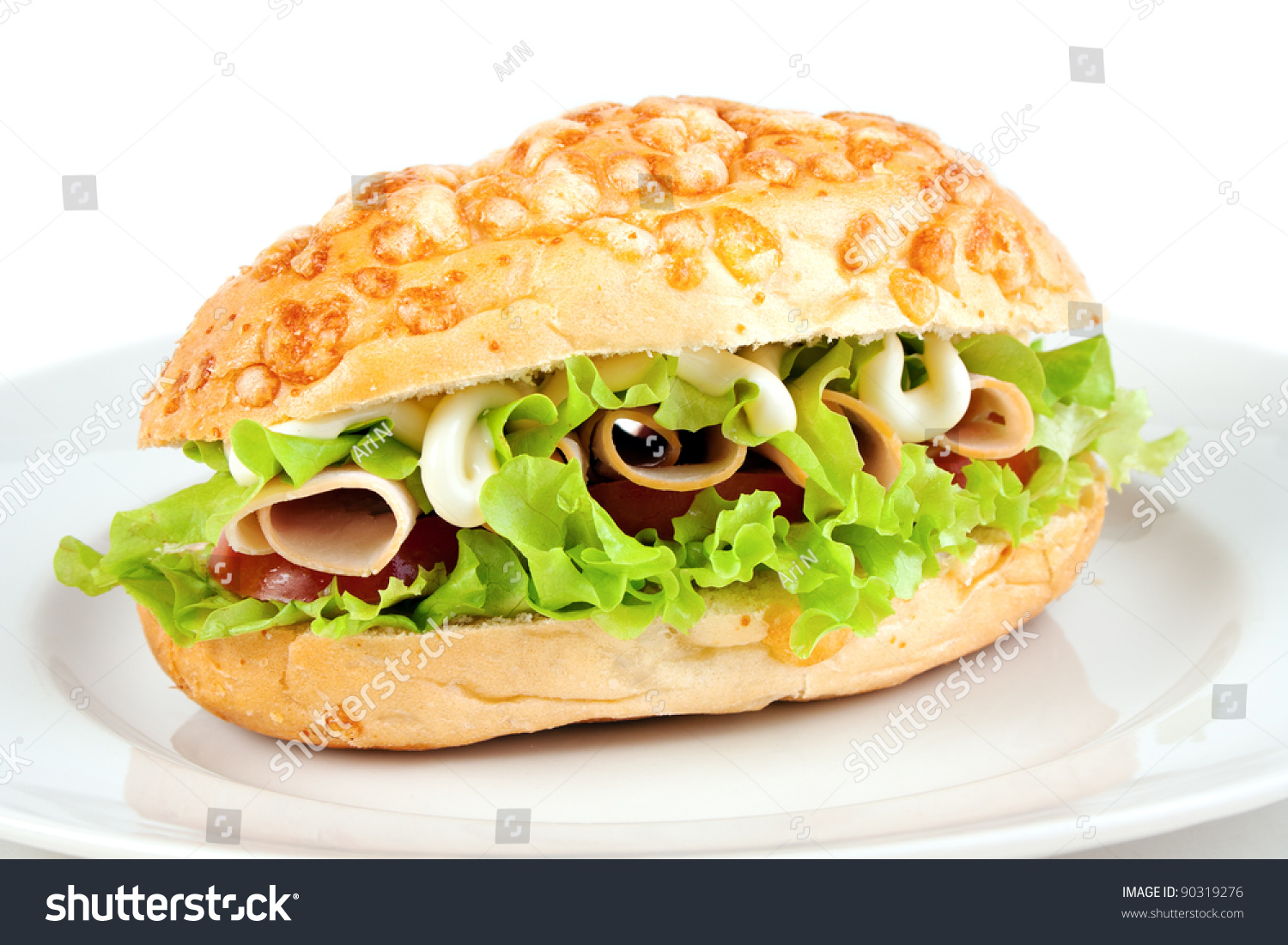 ... roll sandwich with turkey ham, lettuce, tomato and mayonnaise sauce