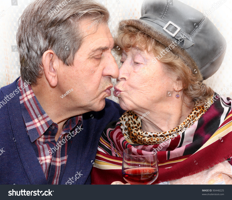 adorable senior couple kissing stock photo 90448225