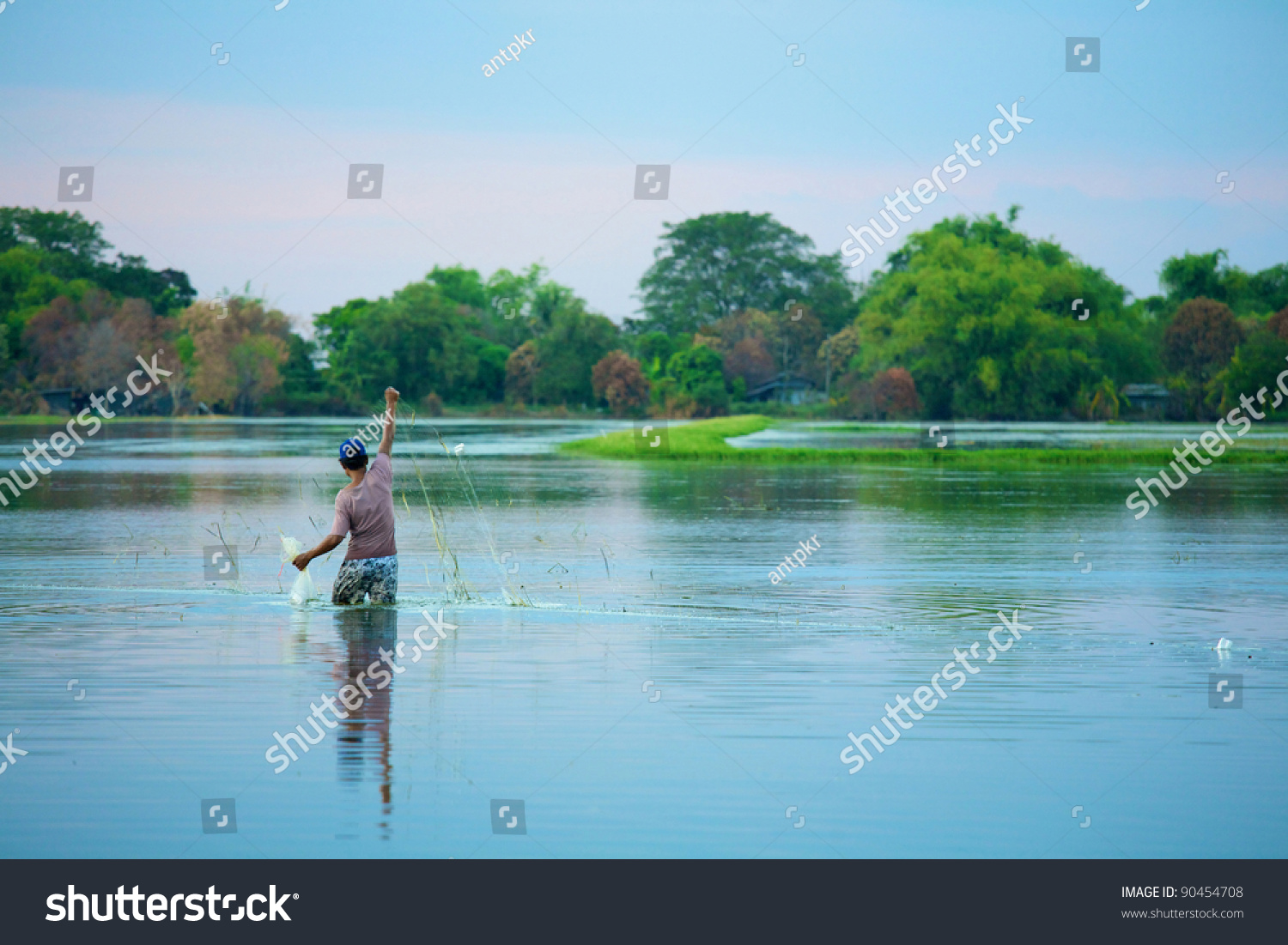 People are catching fish with nets stock photo 90454708 for People catching fish