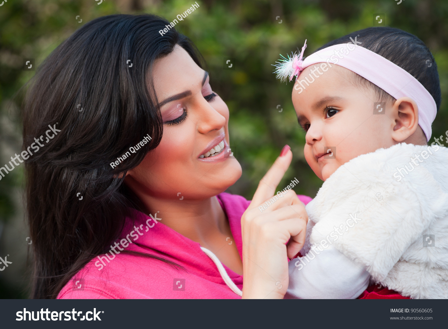 indian family mother holding her little stock photo (royalty free