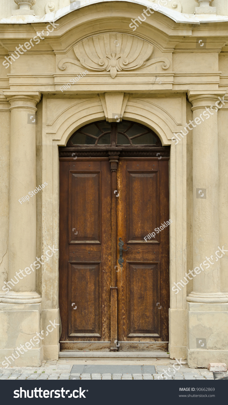 Historical ornate wooden door in a stone entry with arc for Door z prague